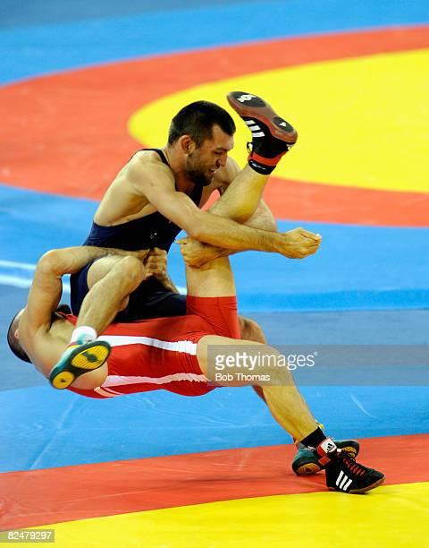Murad Gaidarov of Belarus competes against Chamsulvara Chamsulvarayev of Azerberjan in the 74kg Men's Freestyle wrestling event at the China...