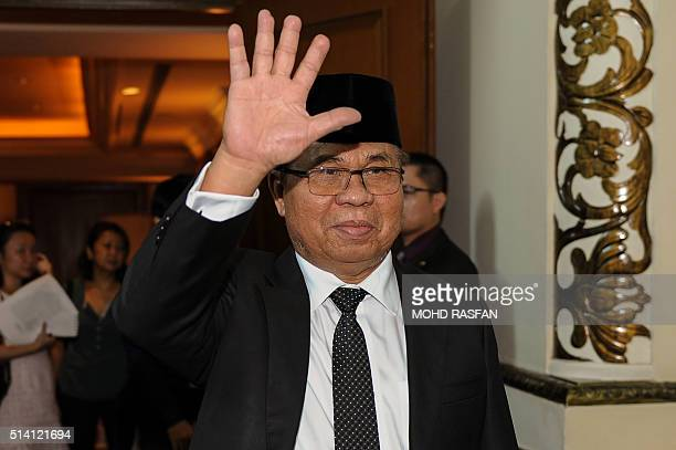 Murad Ibrahim chairman of the southern Philippine rebel group the Moro Islamic Liberation Front gestures during a press conference in Kuala Lumpur on...