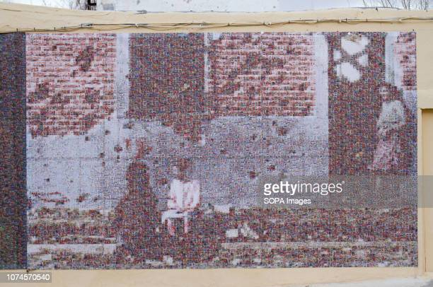 Mural about Robert Capa image seen on the wall of a building. In 1936 Robert Capa took an iconic photography of a building in Entrevías quarter, at...