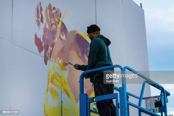 Mural artist Andrew Helm paints at the Upstream Music Festival in Pioneer Square on June 1 2018 in Seattle Washington