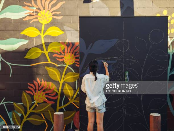 mural artist at work - painter artist stock pictures, royalty-free photos & images
