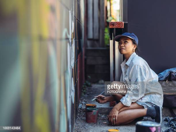 mural artist at work - mural stock pictures, royalty-free photos & images