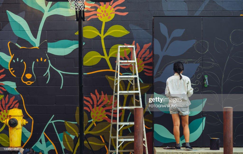 Mural artist at work : Stock Photo