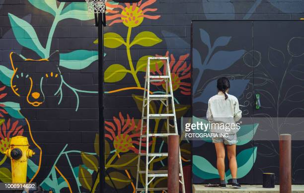 mural artist at work - city life stock pictures, royalty-free photos & images
