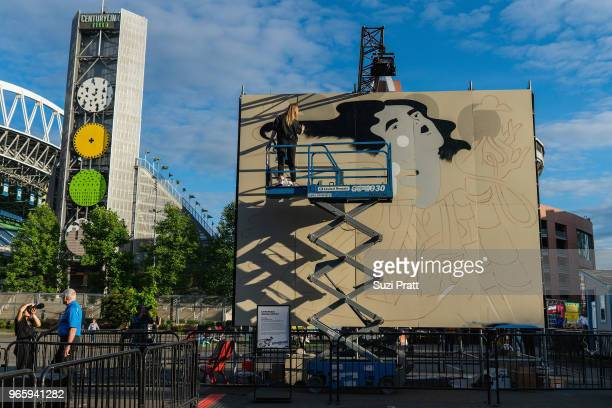 Mural artist Ola Volo paints at the Upstream Music Festival in Pioneer Square on June 1 2018 in Seattle Washington