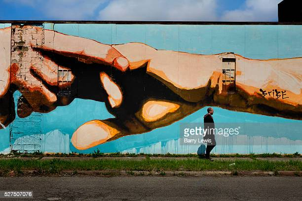 Mural as a homage to Michaelangelo's Sistine Chapel in Rome painted on Grand Boulevard Detroit Known as the world's traditional automotive center...