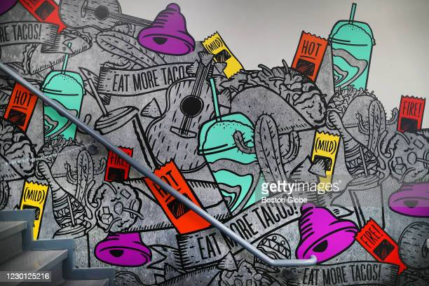Mural at a staircase that goes to an upstairs dining area, which is closed for the pandemic, at the new Taco Bell Cantina in Brookline, MA on Dec. 4,...