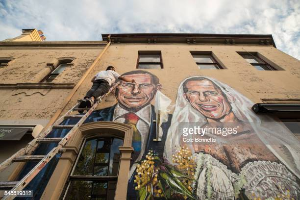 A mural by artist Scott Marsh depicting former Prime Minister Tony Abbott is seen in Redfern on September 11 2017 in Sydney Australia Australians are...