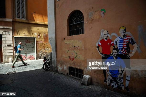 A mural by artist TVBOY depicts US President Donald Trump Russian President Vladimir Putin and Italian Prime Minister Giuseppe Conte on a wall in the...