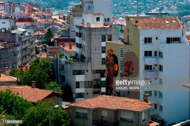 A mural by Colombian street artist Gleo adorns the side of a building in Vigo northwestern Spain on July 9 2019 Since 2015 the city of Vigo has been...