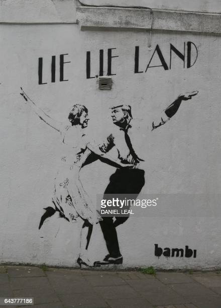 A mural by English street artist Bambi depicting British Prime Minister Theresa May dancing with US President Donald Trump is pictured in London on...