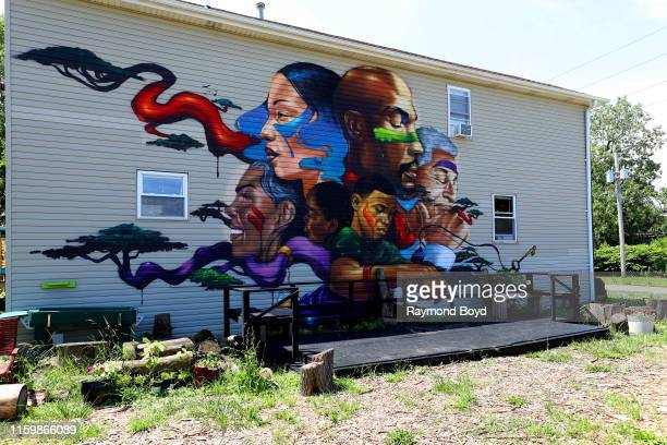 A mural by Max Sansing is displayed at the Sweet Water Foundation's ThinkDo House in the Englewood neighborhood in Chicago Illinois on July 1 2019...