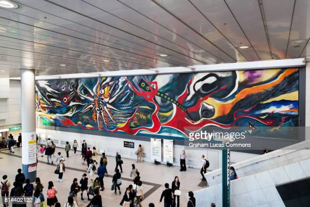 mural by okamoto taro called myth of tomorrow on display in shibuya station, tokyo, japan - 太平洋戦争 ストックフォトと画像