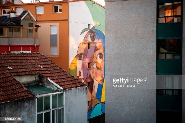 A mural by Spanish street artist Belin adorns the side of a building in Vigo northwestern Spain on July 15 2019 Since 2015 the city of Vigo has been...