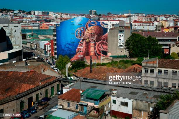 A mural by Spanish street artist Delio adorns the side of a building in Vigo northwestern Spain on July 11 2019 Since 2015 the city of Vigo has been...
