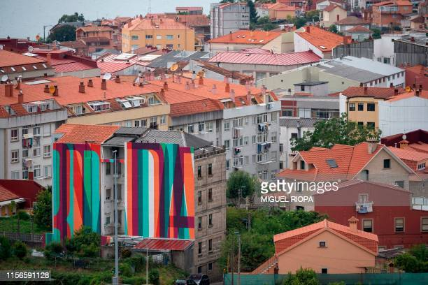 A mural by street art collective Boa Mistura adorns the side of a building in Vigo northwestern Spain on June 25 2019 Since 2015 the city of Vigo has...