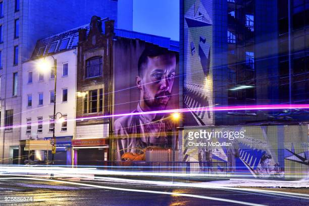 A mural by the artist 'Smug One' known locally as the chef and the lobster looms large on March 1 2018 in Belfast Northern Ireland The striking piece...