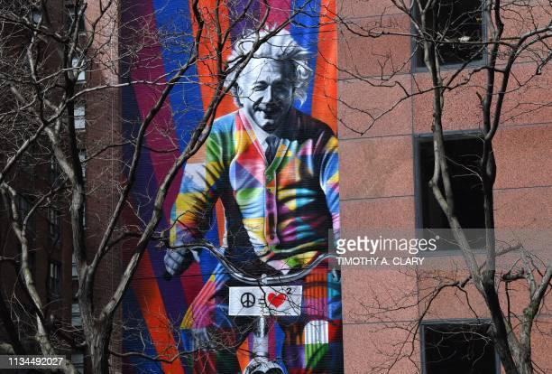 "Mural by world-famous Brazilian street artist Eduardo Kobra of Albert Einstein on a bike titled ""Genius is to bike ride"" in Midtown New York City..."