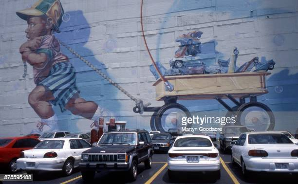 A mural called 'Mass Transit' by Arnold Eyecon at the Renaissance Tower Parking Garage Dallas Texas United States 2002 The mural was painted in 1994
