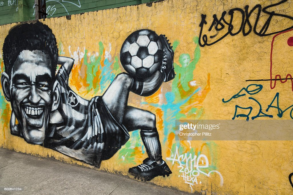 A mural close to the legendary Maracana stadium in Rio de Janeiro depicts some of Brazil's most illustrious footballing legends, such as Taffarell, the '94 World Cup goalkeeper as well as other stars from past campaigns, such as Garrincha whom took Brazil to two consecutive World Cup wins with Pele in 1958 and 1962. He had a tumultuous life on and off the field fathering at least 14 children from two marriages and other affairs and in 1983 he succumbed to cirrhosis of the liver from excessive drinking throughout his adult life, 2013.