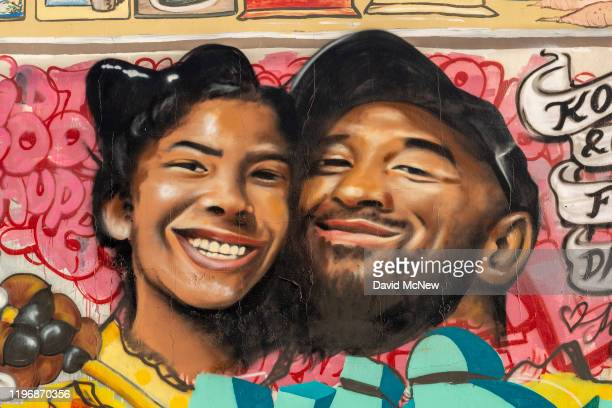 A mural credited to artist Jules Muck memorializing former NBA star Kobe Bryant and his daughter is seen on January 27 2020 in Los Angeles California...