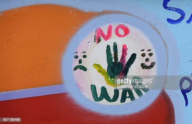 A mural decorates a wall outside the central place where newly arrived refugees have to register near the Bayernkaserne refugee accommodation in...