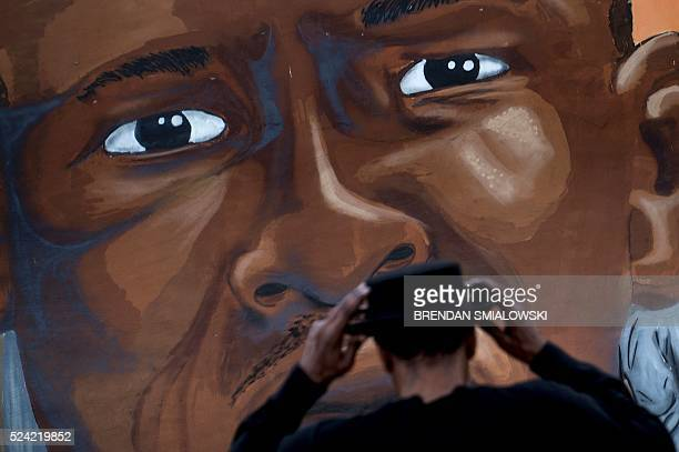 A mural dedicated to Freddie Gray is seen April 25 2016 in Baltimore Maryland a year after the protests that were sparked by Gray's death in police...