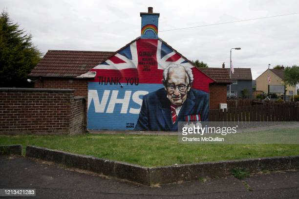 A mural depicting 100 year old army veteran and NHS fund raiser Captain Tom Moore can be seen in a loyalist housing estate on May 18 2020 in Belfast...