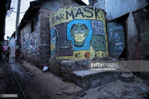 Mural depicting Corona Virus on the streets in Kibera Slums on March 29, 2021 in Nairobi Kenya. After Kenya announced it's third wave hit of the...