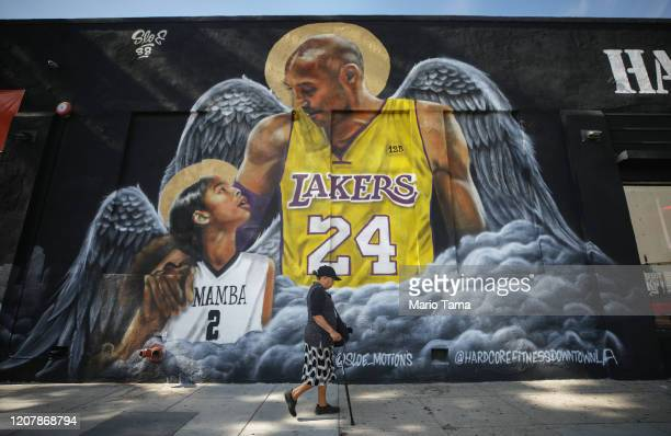 A mural depicting deceased NBA star Kobe Bryant and his daughter Gianna painted by @sloe_motions is displayed on a building on February 13 2020 in...