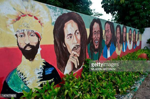 A mural depicting Ethiopian Emperor Haile Selassie I Jamaican Reggae legend Bob Marley and his seven sons is seen on the ground of his museum in...