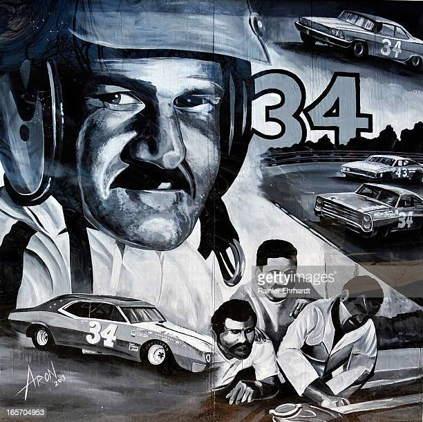 Mural depicting former NASCAR driver Wendell O. Scott Sr. Is shown painted on the side of his garage during a ceremony for the unveiling of a...