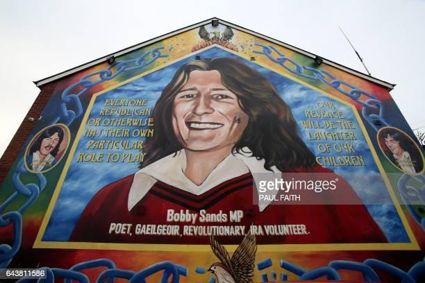 A mural depicting IRA hunger striker Bobby Sands is seen near the Sinn Fein offices in Belfast Northern Ireland on February 22 2017 Sinn Fein's...