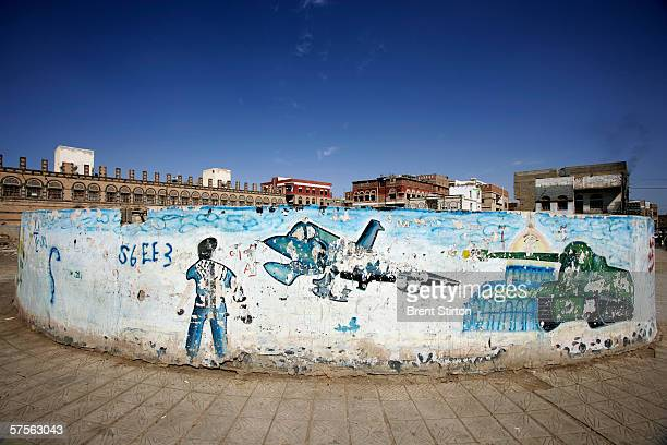 A mural depicting military images is shown Novemebr 20 2005 in Sana'a Yemen Yemen has the second highest percentage of prisoners housed in Guantanamo...