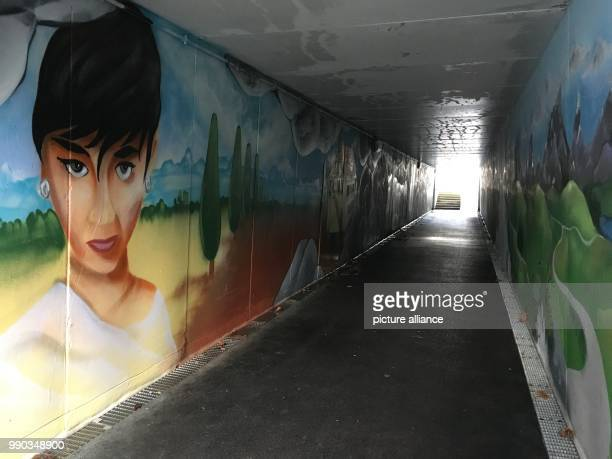 A mural depicting the actress Audrey Hepburn in an underpass by the cemetary where the grave of the actress is situated in Morges Switzerland 07...