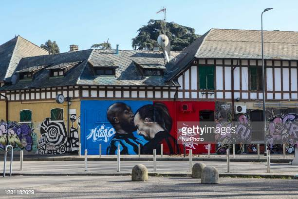 Mural depicting the clash between Zlatan Ibrahimovic of AC Milan and Romelu Lukaku of Inter Milan during the Coppa Italia derby is seen near Stadio...