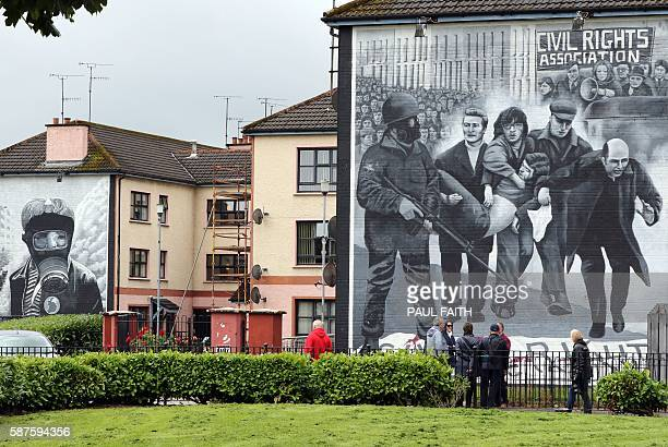A mural depicting the late Bishop Edward Daly waving a white handkerchief is pictured in the Bogside area of Derry Northern Ireland on August 9...