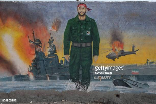A mural depicts the past conflicts between Iran's revolutionary guards and US navy in the Strait of Hormuz on May 2 2017 in Hormuz Island Iran The...