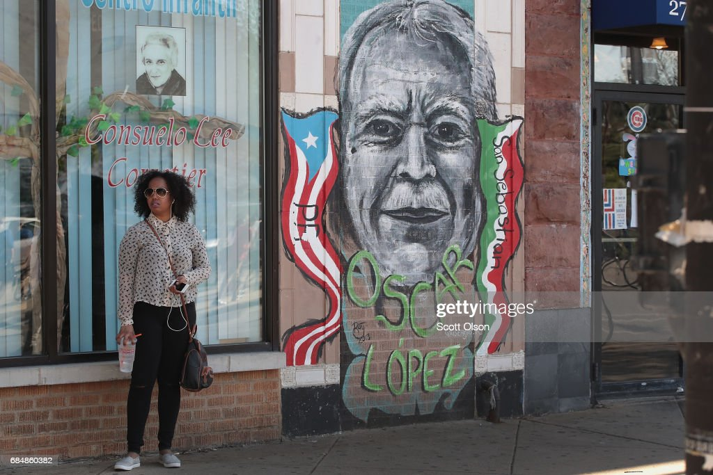A mural featuring Puerto Rican nationalist Oscar López Rivera is painted on a wall in the Humboldt Park neighborhood as the activist and his supporters march by on the way to a rally organized in his honor on May 18, 2017 in Chicago, Illinois. López, who once lived in Chicago was released from federal custody yesterday, his prison sentence being commuted by President Barack Obama before he left office. Lopez was one of the leaders of the Armed Forces of National Liberation (FALN), a Puerto Rican group that claimed responsibility for more than 100 bombings at government buildings, department stores, banks and restaurants in New York, Chicago, Washington D.C. and Puerto Rico during the 1970s and early 1980s.