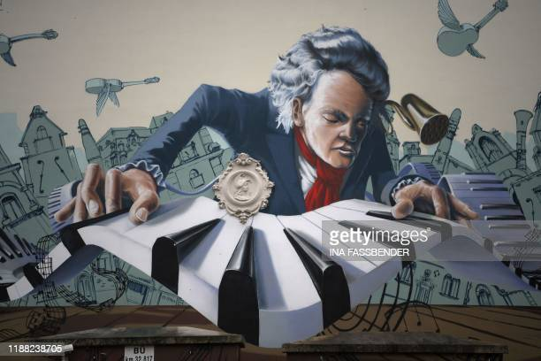 A mural graffiti depicting German composer Ludwig van Beethoven is seen on a house in his native city of Bonn western Germany on December 13 2019...