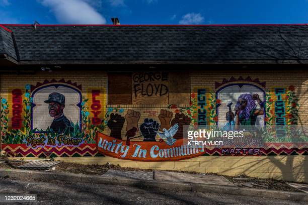 """Mural honoring George Floyd and """"Unity in Community"""" near """"George Floyd Square"""" on March 30, 2021 in Minneapolis, Minnesota. - The teenager who took..."""