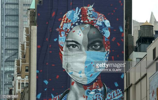 A mural honoring healthcare workers at Montefiore Medical Center in the Bronx is seen on the side of a building in Midtown Manhattan May 11 2020 in...