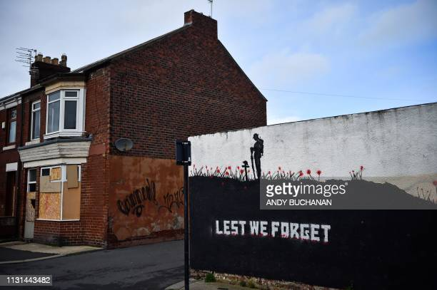 A mural illustrating remembrance is pictured on a wall in Hendon Sunderland in north east England on March 16 2019 The former shipbuilding city in...
