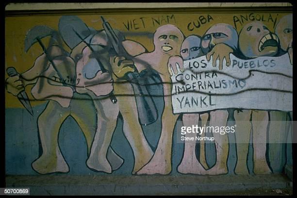 Mural in Panama Canal Zone criticizing American agression in Cuba Angola and Vietnam w the message Los Pueblos contra Imperialismo Yanki