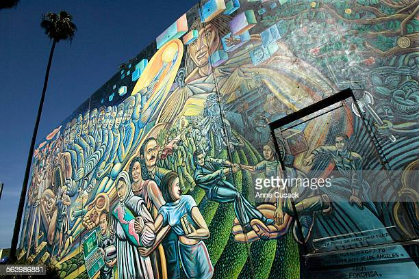 A mural in Salazar Park along Whittier Boulevard in East Los Angeles by Paul Botello entitled The Wall that Speaks Sings and Shouts speaks to the...