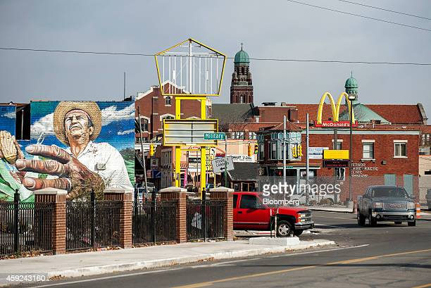 Mural is displayed on the side of a wall in the Mexicantown neighborhood of Southwest Detroit, Michigan, U.S., on Tuesday, Nov. 18, 2014. An influx...