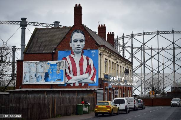 TOPSHOT A mural is pictured showing the Sunderland football legend Raich Carter painted by Frank Styles on the side of the Blue House public house in...