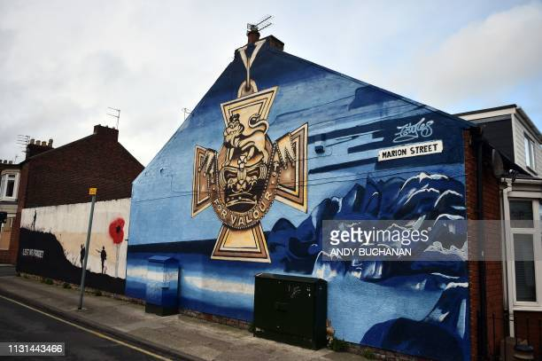 A mural is pictured showing the Victoria Cross painted by Frank Styles on the side of a house in Hendon Sunderland in north east England on March 16...