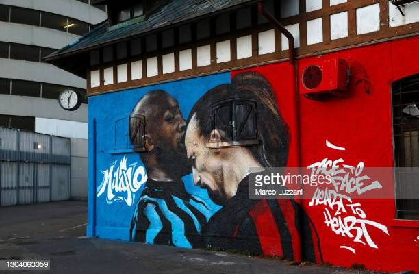 Mural is seen on a building outside the stadium of Romelu Lukaku of FC Internazionale as he clashes with Zlatan Ibrahimovic of AC Milan ahead of the...