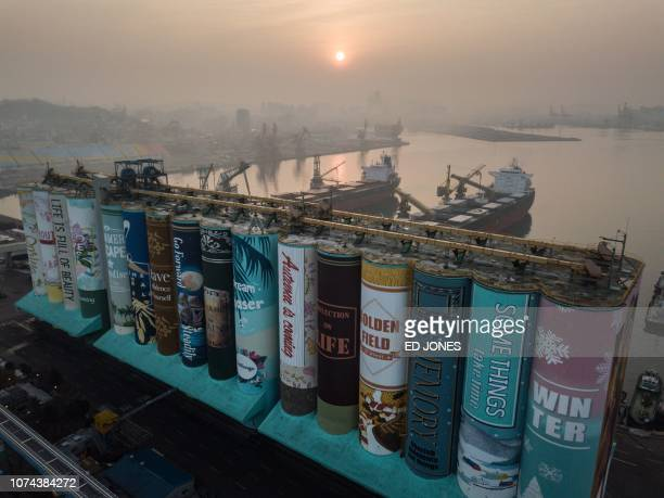 TOPSHOT A mural listed by the Guinness World Records as the largest in the world is displayed on a grain silo in Incheon port west of Seoul on...